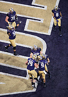 The Huskies celebrate Myles Gaskin's first touchdown of the game.