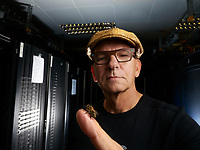 Portrait of Gerhard Vonend, IT engineer, in front of the digital storage center of the Hobos research center.<br /> Hobos- Universit&eacute; de W&uuml;rzburg, Allemagne. Portrait de Gerhard Vonend, Ing&eacute;nieur IT devant le centre de stockage num&eacute;rique du centre de recherche Hobos.