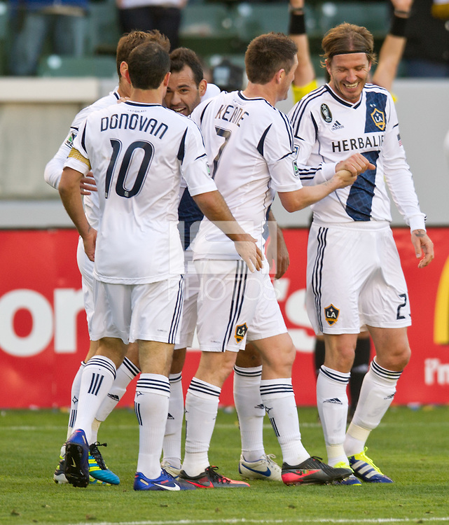 CARSON, CA - March 18,2012: LA Galaxy players celebrating a goal during the LA Galaxy vs DC United match at the Home Depot Center in Carson, California. Final score LA Galaxy 3, DC United 1.
