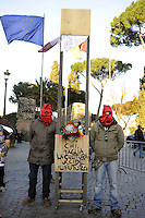 Roma, 7 Marzo 2011.Protesta in maschera in Piazza del Campidoglio dei centri sociali in Action conro i mancati finanziamenti ai Carnevali di periferia..Si inscena la decapitazione di Arlecchino con ghigliottina e boia