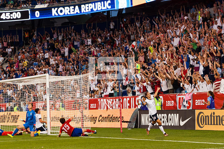 United States (USA) fans celebrate the fourth goal of forward Abby Wambach (20). The women's national team of the United States defeated the Korea Republic 5-0 during an international friendly at Red Bull Arena in Harrison, NJ, on June 20, 2013.