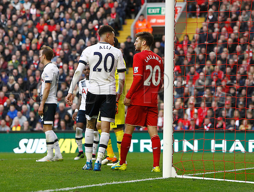 02.04.2016. Anfield, Liverpool, England. Barclays Premier League. Liverpool versus Tottenham Hotspur. Spurs midfielder Dele Alli and Liverpool midfielder Adam Lallana exchange words after some pushing and shoving on the goal line.