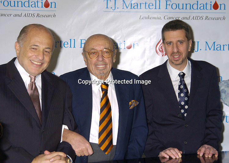 Doug Morris, Ahmet Ertegun and Jason Flom ..at a Luncheon on February 8, 2005 at the Sony Club to announce the kick-off of the upcoming 30th Anniversary gala celebration of the TJ Martell Foundation in May. ..Photo by Robin Platzer, Twin Images