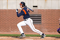 Jarrett Parker #3 of the Virginia Cavaliers follows through on his swing versus the East Carolina Pirates at Clark-LeClair Stadium on February 19, 2010 in Greenville, North Carolina.   Photo by Brian Westerholt / Four Seam Images
