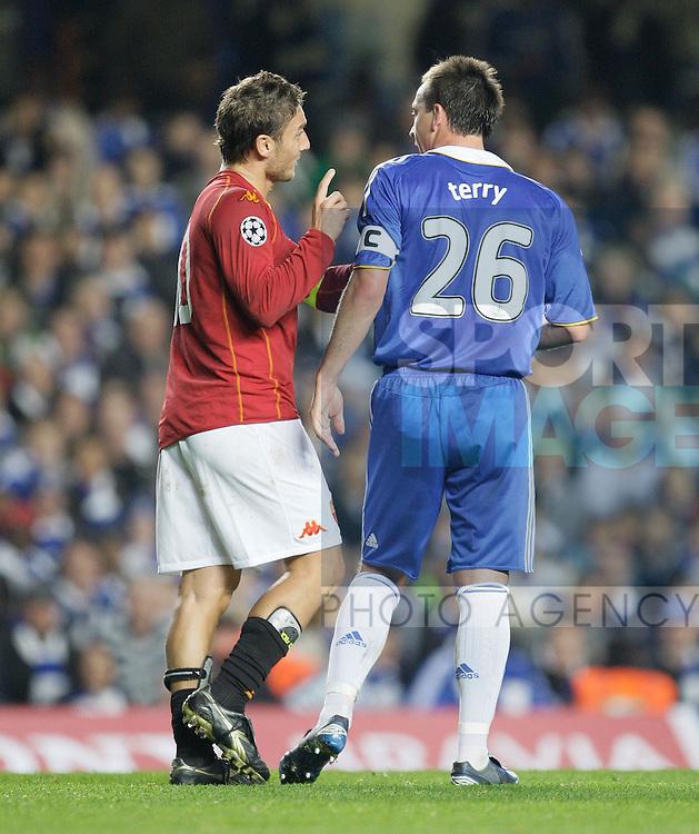 AS Roma's Francesco Totti raises his finger at Chelsea`s John Terry.