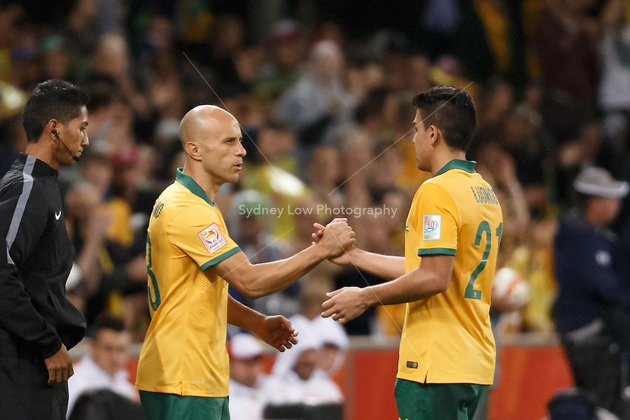 Massimo LUONGO comes off for Mark BRESCIANO of Australia in match 1 of the 2015 AFC Asian Cup at the Melbourne Rectangular Stadium on 9 January 2015.
