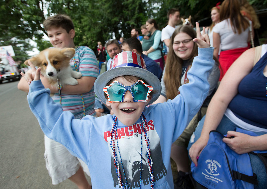 Connor Rapp, reacts to getting candy from passing floats at the Fourth of July Parade in Ridgefield Monday July 4, 2016. (Photo by Natalie Behring/ for the The Columbian)