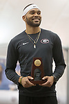 COLLEGE STATION, TX - MARCH 11: Devon Williams of Georgia smiles with his first place trophy following the men's heptathlon during the Division I Men's and Women's Indoor Track & Field Championship held at the Gilliam Indoor Track Stadium on the Texas A&M University campus on March 11, 2017 in College Station, Texas. (Photo by Michael Starghill/NCAA Photos/NCAA Photos via Getty Images)