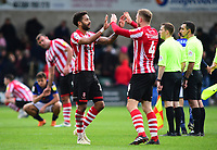 Lincoln City's Bruno Andrade, left, celebrates at the final whistle with Michael O'Connor<br /> <br /> Photographer Andrew Vaughan/CameraSport<br /> <br /> The EFL Sky Bet League Two - Lincoln City v Crewe Alexandra - Saturday 6th October 2018 - Sincil Bank - Lincoln<br /> <br /> World Copyright &copy; 2018 CameraSport. All rights reserved. 43 Linden Ave. Countesthorpe. Leicester. England. LE8 5PG - Tel: +44 (0) 116 277 4147 - admin@camerasport.com - www.camerasport.com