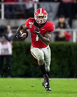 ATHENS, GA - NOVEMBER 23: D'Andre Swift #7 of the Georgia Bulldogs runs with the ball during a game between Texas A