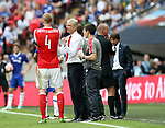 Per Mertesacker of Arsenal talks to Arsene Wenger manager of Arsenal during the Emirates FA Cup Final match at Wembley Stadium, London. Picture date: May 27th, 2017.Picture credit should read: David Klein/Sportimage