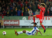 Ethan Ampadu of Wales (R) avoids a tackle by Ricardo Avila of Panama during the international friendly soccer match between Wales and Panama at Cardiff City Stadium, Cardiff, Wales, UK. Tuesday 14 November 2017.
