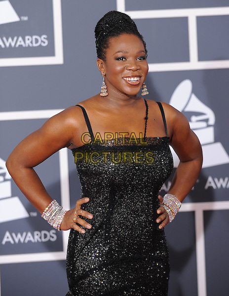 INDIA ARIE .Arrivals at the 52nd Annual GRAMMY Awards held at The Staples Center in Los Angeles, California, USA..January 31st, 2010.grammys half length black sparkly dress hands on hips diamond bracelets .CAP/RKE/DVS.©DVS/RockinExposures/Capital Pictures