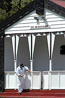 The wharenui, or the main meeting house of a Māori marae, for the community of Te Rawhiti gets a new coat of paint. Rawhiti is a small beachfront town in the Bay of Islands region of New Zealand.