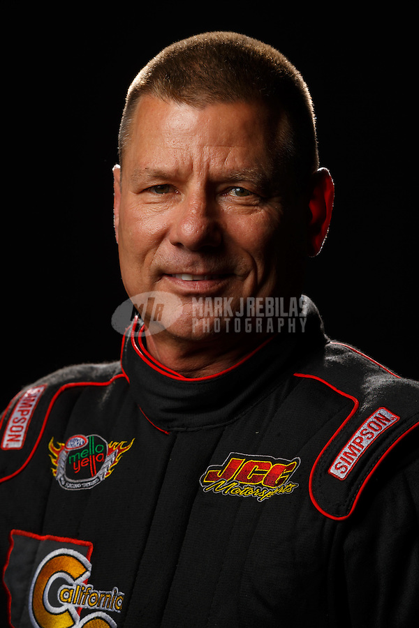 Feb 10, 2016; Pomona, CA, USA; NHRA funny car driver Jim Campbell poses for a portrait during media day at Auto Club Raceway at Pomona. Mandatory Credit: Mark J. Rebilas-USA TODAY Sports