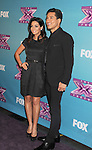 LOS ANGELES, CA - DECEMBER 20: Courtney Mazza and Mario Lopez attend the FOX's 'The X Factor' Season Finale - Night 2 at CBS Televison City on December 20, 2012 in Los Angeles, California.