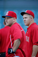 Mike Trout #27 of the Los Angeles Angels with teammate Chris Iannetta before a game against the Detroit Tigers at Angel Stadium on April 19, 2013 in Anaheim, California. (Larry Goren/Four Seam Images)