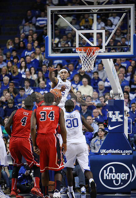 UK forward Willie Cauley-Stein (15) blocks a shot from Ole Miss guard Ladarius White (10) during second the half of UK Men's Basketball vs. Ole Miss at Rupp Arena in Lexington, Ky., on Tuesday, February 4, 2014. Photo by Emily Wuetcher | Staff