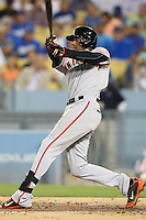 September 24, 2014 Los Angeles, CA: San Francisco Giants third baseman Joaquin Arias #13  during an MLB game between the San Francisco Giants and the Los Angeles Dodgers played at Dodger Stadium The Dodgers defeated the Giants 9-1 to win the National League West Title.