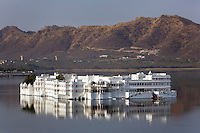 The LAKE PALACE HOTEL on JAGNIWAS ISLAND was built by Maharaja Jagat Singh ll in 1754 and rises from LAKE PICHOLA in UDAIPUR - RAJASTHAN, INDIA
