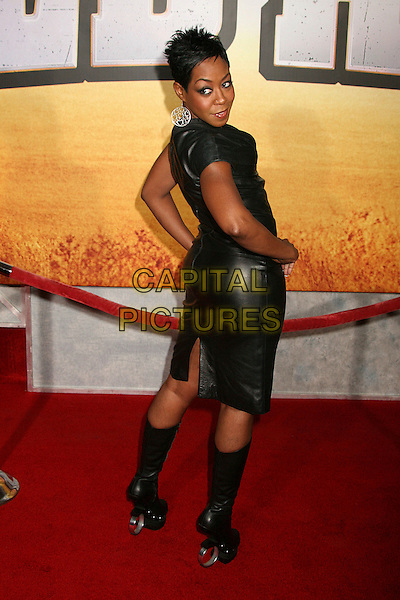 "TICHINA ARNOLD.""Wild Hogs"" Los Angeles Premiere at the El Capitan Theatre, Hollywood, California, USA..February 27th, 2007.full length black skirt top boots leather hands on hips heels rings hoops shoes looking over shoulder.CAP/ADM/BP.©Byron Purvis/AdMedia/Capital Pictures"