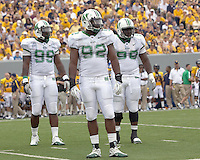 Marshall defensive line. The WVU Mountaineers beat the Marshall Thundering Herd 34-13 in a game called just after the fourth quarter started because of severe thunderstorms in the area. The game was played at Milan Puskar Stadium in Morgantown, West Virginia on September 4, 2011.