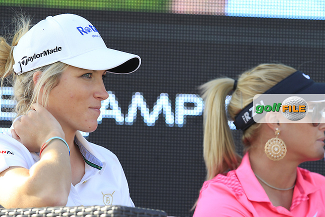 Melisse Reid (ENG) and Carly Booth (SCO) talk in the tented village during Friday's Round 2 of the Abu Dhabi HSBC Golf Championship 2015 held at the Abu Dhabi Golf Course, United Arab Emirates. 16th January 2015.<br /> Picture: Eoin Clarke www.golffile.ie