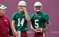 TALLAHASSEE, FLA.8/6/13-FSU080613CH-Florida State quarterback Jacob Coker, center, and Jameis Winston, right, during practice with Quarterbacks Coach Randy Sanders, left,  Aug. 6, 2013 in Tallahassee, Fla.<br /> <br /> COLIN HACKLEY PHOTO