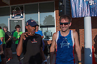 Meb Keflezghi and Fleet Feet's Andy Koziatek talk before heading out for the Run with Meb run at the Fleet Feet Des Peres Store in Des Peres, MO. Wednesday, September 3, 2014.