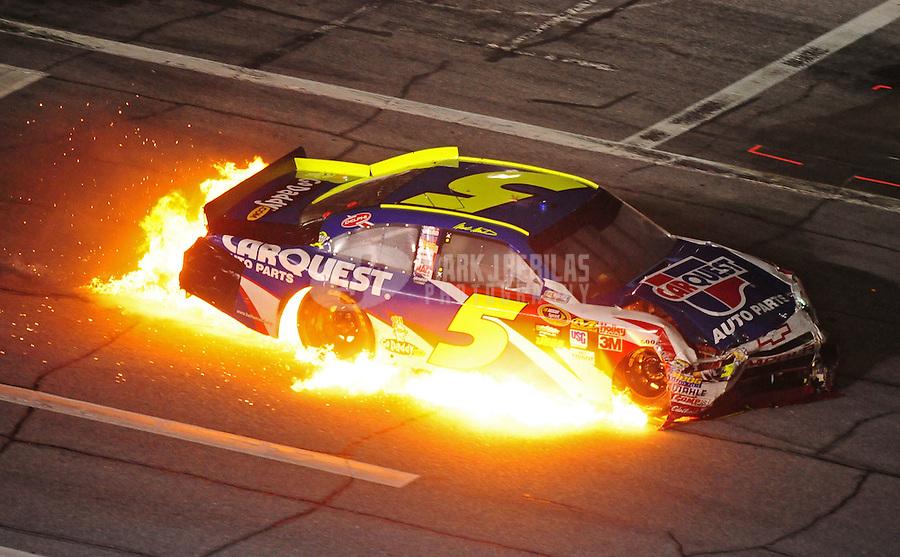 Jul. 3, 2010; Daytona Beach, FL, USA; Flames pour from the car of NASCAR Sprint Cup Series driver Mark Martin (5) during the Coke Zero 400 at Daytona International Speedway. Mandatory Credit: Mark J. Rebilas-