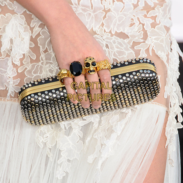 "Agnes Monica's bag.""Oblivion"" Los Angeles Premiere held at the Dolby Theatre, Hollywood, California, USA..April 10th, 2013.hand detail clutch bag knuckleduster rings skull white sheer lace .CAP/ADM/BP.©Byron Purvis/AdMedia/Capital Pictures."