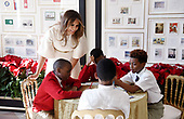First Lady Melania Trump participates in arts and crafts projects with children and students from Joint Base Andrews in the Booksellers area of the White House in Washington, DC, November 27, 2017.<br /> Credit: Olivier Douliery / Pool via CNP