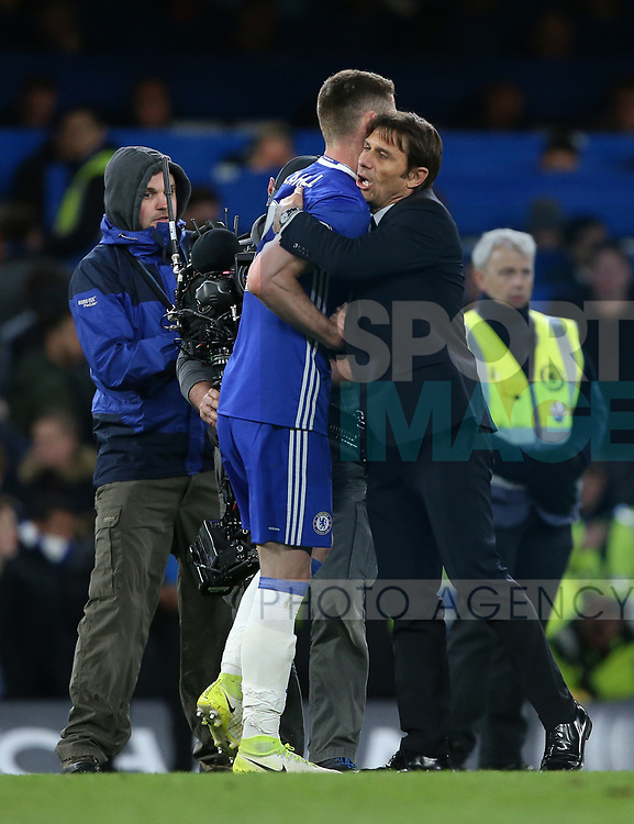 Chelsea's Antonio Conte with Gary Cahill during the Premier League match at Stamford Bridge Stadium, London. Picture date: April 25th, 2017. Pic credit should read: David Klein/Sportimage