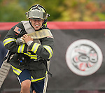 Vancouver, Canada, Aug 6th 2009.  World Police and Fire Games, Ultimate Firefighter Competition. Competitor Beau Grubb from the Seattle Port Fire Department, Washington, USA, pulls hard during the Hose Task portion of the competition. In this stage, competitors must drag two 150-foot long 2 ½-inch fire hoses their full length plus 30 feet, and then move to another station and roll up two 50-foot sections of hose and carry them back to the finish line.  Beau finished 10th in the senior A (ages 30-34) division with a combined time of 5:10.49 in the four stages.  Photo by Gus Curtis