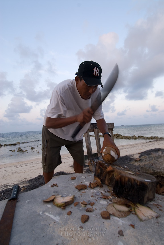 Chopping coconuts, Comarca De Kuna Yala, San Blas Islands, Panama