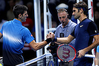 Roger Federer of Switzerland shakes hands with Novak Djokovic of Serbia at the ATP World Tour Finals, The O2, London, 2015