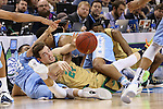 14 March 2015: Notre Dame's Pat Connaughton (24) wins a loose ball between North Carolina's Justin Jackson (left) and Isaiah Hicks (right). The Notre Dame Fighting Irish played the University of North Carolina Tar Heels in an NCAA Division I Men's basketball game at the Greensboro Coliseum in Greensboro, North Carolina in the ACC Men's Basketball Tournament quarterfinal game. Notre Dame won the game 90-82.