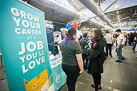 Workers from Planted speak to attendees at the TechDay New York event on Tuesday, April 18, 2017. Thousands attended to seek jobs with the startups and to network with their peers. TechDay bills itself as the U.S.'s largest startup event with over 500 exhibitors. (© Richard B. Levine)