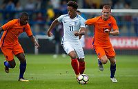 Chris Willock (Benfica) of England U20 with Dani De Wit (Jong Ajax) & Sherel Florins (2) (Sparta Rotterdam) of Netherlands during the International friendly match between England U20 and Netherlands U20 at New Bucks Head, Telford, England on 31 August 2017. Photo by Andy Rowland.