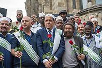 """Der """"Marsch der Muslime gegen Terrorismus"""" am Sonntag den 9. Juli 2017 in Berlin.<br /> Etwa sechzig Imame aus Frankreich und anderen europaeischen Laendern, darunter auch sechs Imame aus Berlin werden ab dem 9. Juli 2017 in europaeische Staedte fahren, wo es in den letzten Jahren besonders schwere islamistisch motivierte Terroranschlaege gegeben hat.In Berlin versammelten sie sich zusammen mit Mitgliedern der christlichen und juedischen Gemeinde an der Kaiser-Wilhelm-Gedaechtnis-Kirche in Berlin-Charlottenburg wo im Dezember 2016 einen Anschlag auf den Weihnachtsmarkt gegeben hatte.<br /> Der franzoesische Imam Hassen Chalghoumi aus dem Pariser Vorort Drancy engagiert sich seit vielen Jahren fuer ein friedliches Miteinander der Religionen, insbesondere im Verhaeltnis der Muslime zum Judentum. Zusammen mit seinem Freund, dem juedischen Schriftsteller Marek Halter, der seit Jahrzehnten in gleicher Weise engagiert ist hat er den """"Marche des musulmans contre le terrorisme"""" initiert. Sie wollen nach Bruessel, Paris, St.-Etienne-du-Rouvray, Toulouse und Nizza und dort oeffentlich fuer die Opfer beten und gegen einen Missbrauch des Islam durch Terroristen und menschenfeindliche Gruppen eintreten.<br /> Die Evangelische Kirche Berlin-Brandenburg-schlesische Oberlausitz unterstuetzt das Anliegen der """"Marche des musulmans contre le terrorisme"""". Der Landesbischof Dr. Markus Droege hat an dem Gebet der Muslime auf dem Breitscheidplatz als Gast teilgenommen und einen Segen fuer die Teilnehmer ausgesprochen.<br /> Im Bild: 2.vr. Marek Halter; 3.vr Imam Chalghoumi.<br /> 9.7.2017, Berlin<br /> Copyright: Christian-Ditsch.de<br /> [Inhaltsveraendernde Manipulation des Fotos nur nach ausdruecklicher Genehmigung des Fotografen. Vereinbarungen ueber Abtretung von Persoenlichkeitsrechten/Model Release der abgebildeten Person/Personen liegen nicht vor. NO MODEL RELEASE! Nur fuer Redaktionelle Zwecke. Don't publish without copyright Christian-Ditsch.de, Veroeffentlichung nur mit Fotogra"""