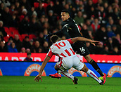 2nd December 2017, bet365 Stadium, Stoke-on-Trent, England; EPL Premier League football, Stoke City versus Swansea City; Martin Olsson of Swansea City escapes the attention of Eric Maxim Choupo-Moting of Stoke City