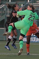 Flash\'s Marta fights for the ball as Sky Blue keeper Jenni Branam and defender Anita Asante protect the goal. The game ended in a 2-2 tie