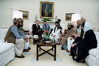 2/2/1983 President Reagan meeting with Afghan Freedom Fighters in the Oval Office to discuss Soviet atrocities in Afghanistan.<br /> <br /> In clockwise order:  Ronald Reagan; Gust Avrakotos; Muhammad Omar Babarakzai; Mohammad Ghafoor Yousefzai; Habib-Ur-Rehman Hashemi; Farida Ahmadi; Mir Niamatullah and Gul Mohammad.<br /> <br /> PHOTO : Unknown, possibly Tim Clary