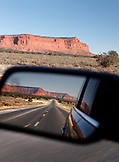 USA, Utah, Big Water, view of the road and red rock formations in the side view mirror, Hwy 89