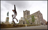 John Sellars, a passing Paisley Buddie, passes some of the town's symbolic attributes that may lead to City status - a statue to the poet Tannahill, and the Abbey  ..... picture by Donald MacLeod  25.07 .01