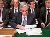 """Jerome H. Powell, Chairman, Board of Governors of the Federal Reserve System studies his notes prior to giving testimony before the United States Senate Committee on Banking, Housing, and Urban Affairs on """"The Semiannual Monetary Policy Report to the Congress"""" on Capitol Hill in Washington, DC on Thursday, March 1, 2018<br /> Credit: Ron Sachs / CNP"""