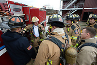NWA Democrat-Gazette/ANDY SHUPE<br /> Battalion Chief Willie Watts (center) and Capt. Shane Wood (left) show how to test a pressure gauge Wednesday, March 13, 2019, while working on high rise firefighting training at the department's training facility in south Fayetteville. City voters will head to the polls April 9 to consider 10 bond questions totaling more than $226 million in projects. About $15 million is included for the Fire Department for three new fire stations, trucks and equipment.
