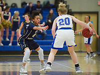 NWA Democrat-Gazette/CHARLIE KAIJO Bentonville West High School guard Kelsie Mahone (4) covers Rogers High School guard London Hatch (20) during a basketball game, Friday, February 8, 2019 at Rogers High School in Rogers.
