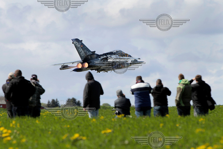 A German Tornado takes off during spotters day at Ørland Air Base in Norway. Airplane spotters came from all over the world to see the tiger aircrafts. Nato Tiger Meet is an annual gathering of squadrons using the tiger as their mascot. While originally mostly a social event it is now a full military exercise. Tiger Meet 2012 was held at the Norwegian air base Ørlandet.