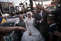 In this Thursday, Aug. 08, 2013 photo, a couple and supporters of the ousted president Mohammed Morsi pgets married at the sit-in of the Cairo University at Giza district. (Photo/Narciso Contreras).